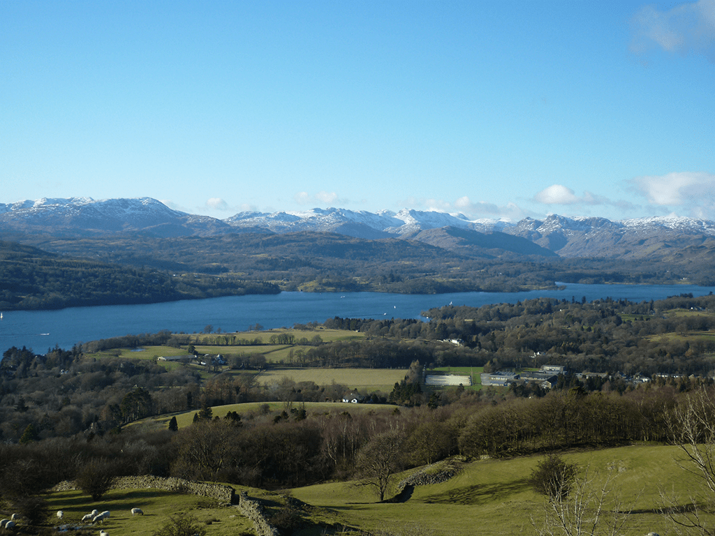 Distance shot of Lake Windemere showing snow capped mountains